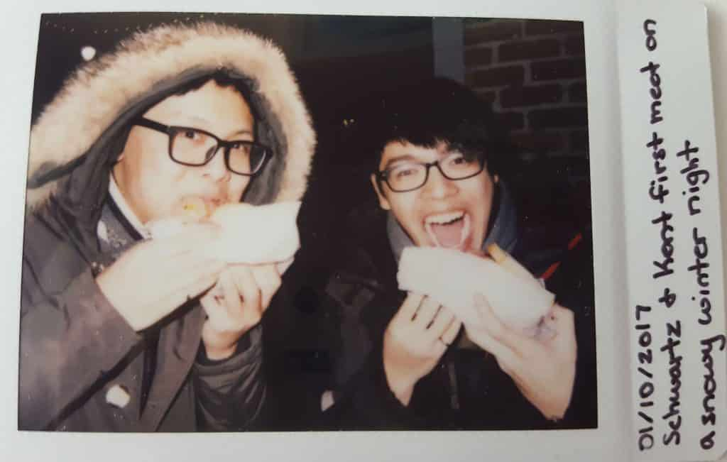 Instax Memory - Kent and Anson outside of Schwartz eating smoked meat sandwhiches in the winter