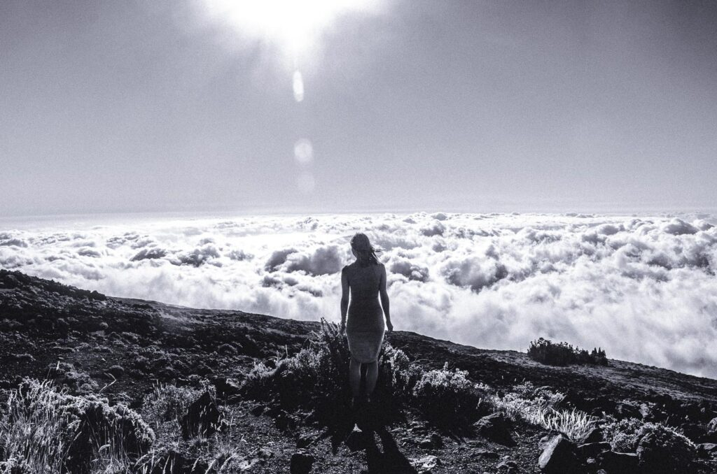 BW Image - Woman standing on the slopes of Haleakala watching the clouds drift