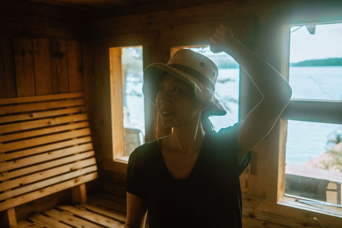 Woman exploring the inside of the sauna located at Pine Falls Lodge